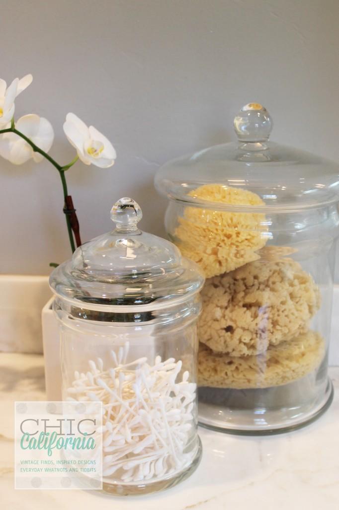 q tips in jar, orchid, sea sponges