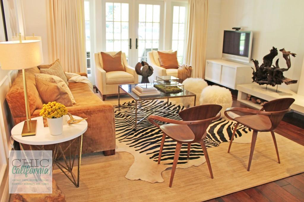 modern living room, zebra rug, fuzzy poofs