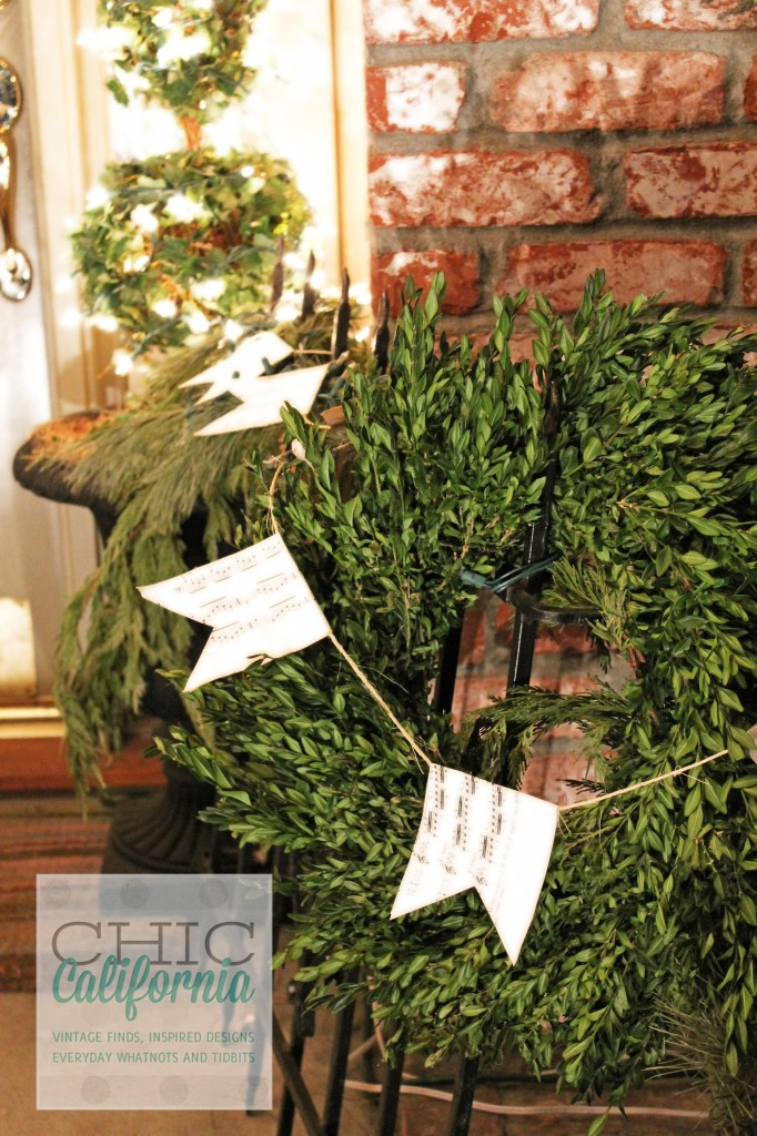 boxwood wreath, front porch decorations, music sheet garland