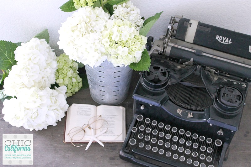 vintage olive bucket and typewriter
