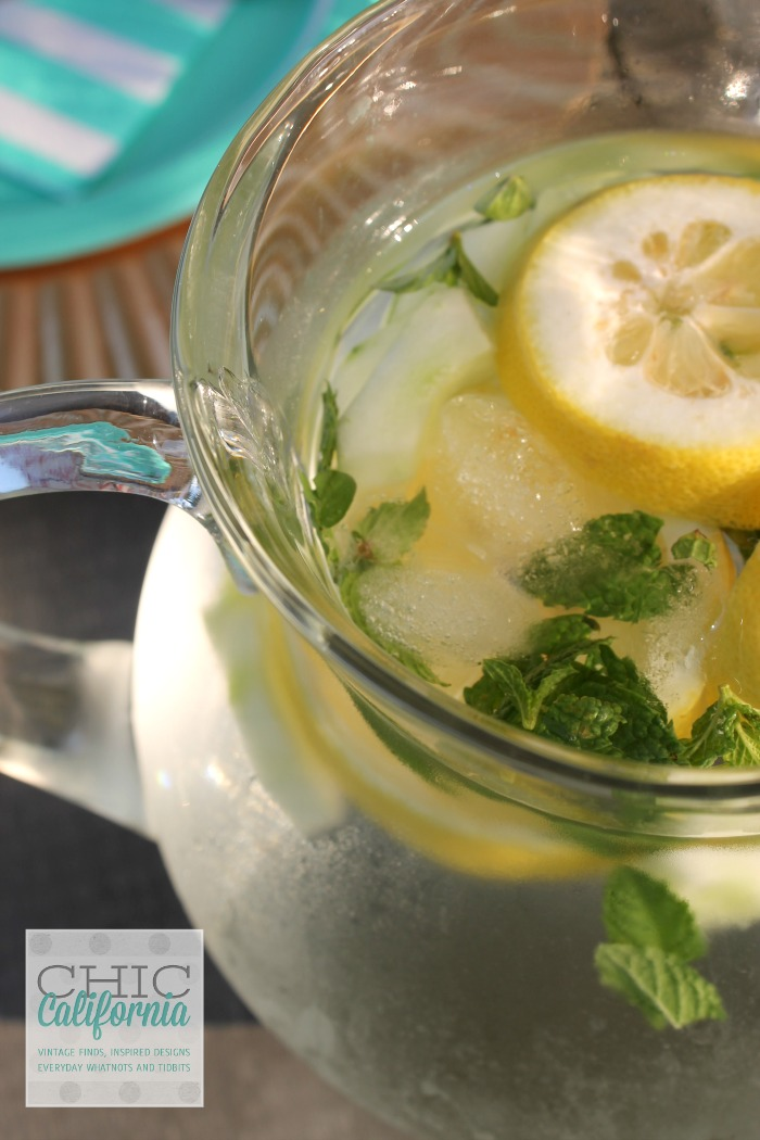 pitcher of water with lemon and mint