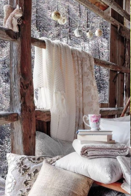 Layered winter white pillows and blankets