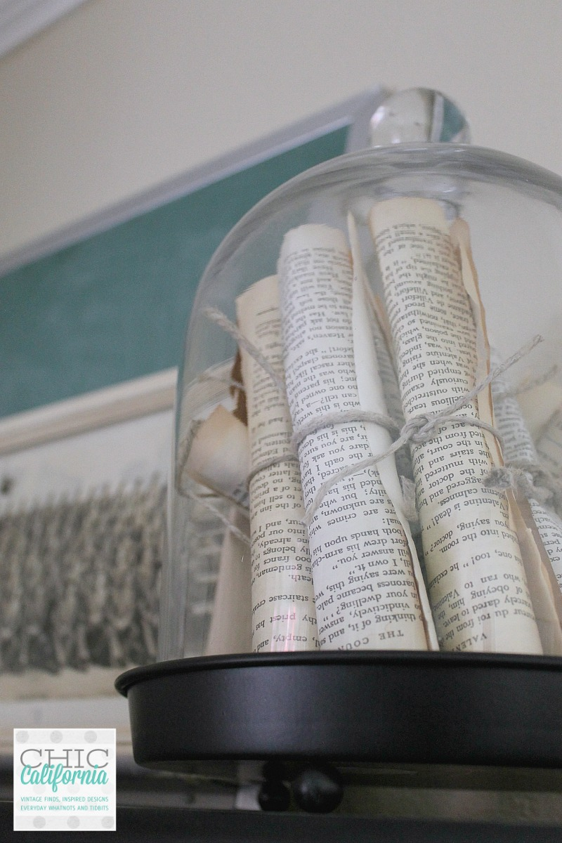 Vintage books rolled under glass dome