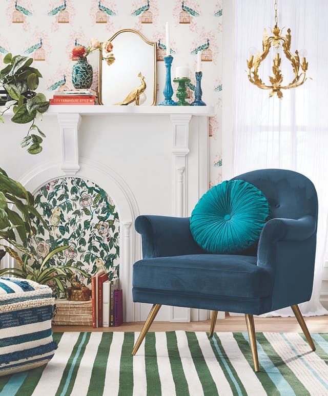 Teal chair with gold legs, green striped rug and gold chandelier