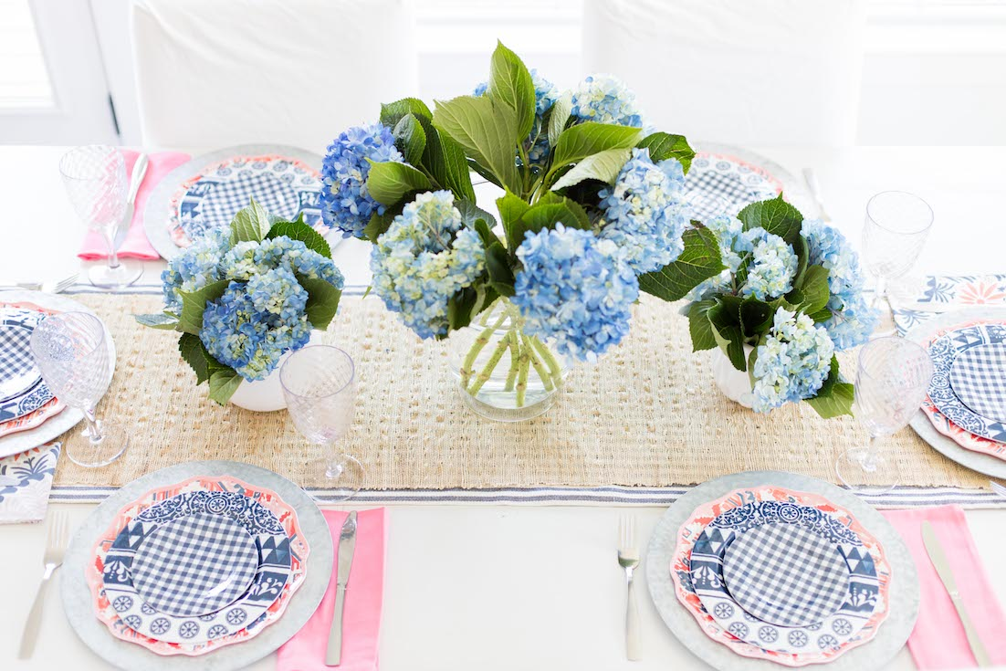 blue hydrangea centerpiece with blue and pink dishes