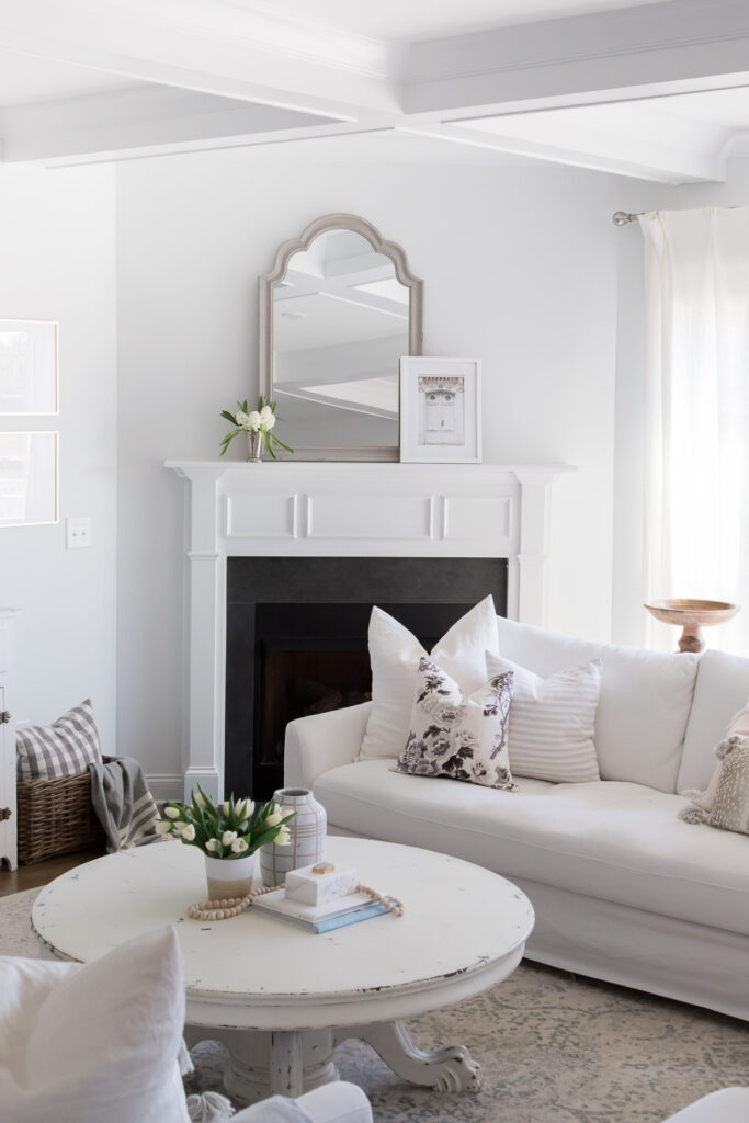 Do you love white bright spaces? You are going to love this Light and Bright Spring Home Tour and spring decorating ideas | Adrienne Elizabeth Home Style Life| #springhometour #springdecor #whitedecor #modernfarmhouse #modernfarmhousestyle #springflowers #springdecorideas #whitefireplace #jillianharrisstyle #monikahibbsstyle #whitecouch #studiomcgeestyle #springmanteldecor #vintagedecor #graydecor