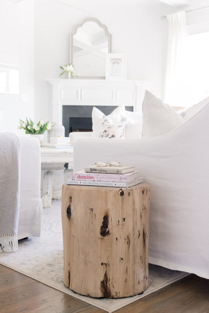 Do you love white bright spaces? You are going to love this Light and Bright Spring Home Tour and spring decorating ideas | Adrienne Elizabeth Home Style Life| #springhometour #springdecor #whitedecor #modernfarmhouse #modernfarmhousestyle #springflowers #springdecorideas #jillianharrisstyle #monikahibbsstyle #studiomcgeestyle #familyroomdecor #livingroomdecor #woodsidetable #whitecouch #woodsandwhites