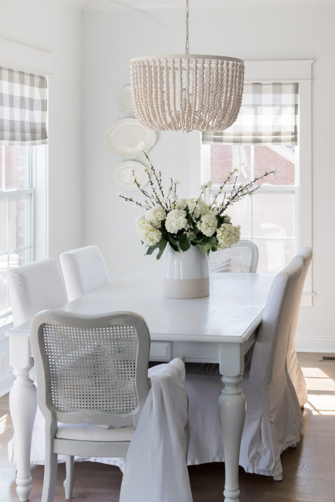 Do you love white bright spaces? You are going to love this Light and Bright Spring Home Tour and spring decorating ideas | Adrienne Elizabeth Home Style Life| #springhometour #springdecor #whitedecor #modernfarmhouse #modernfarmhousestyle #springflowers #springdecorideas #floralpillow #pillowstyle #jujuhat #tobaccobasket #jillianharrisstyle #monikahibbsstyle #whitecouch #studiomcgeestyle #ikeacouch #farlovcouch #vintagedecor