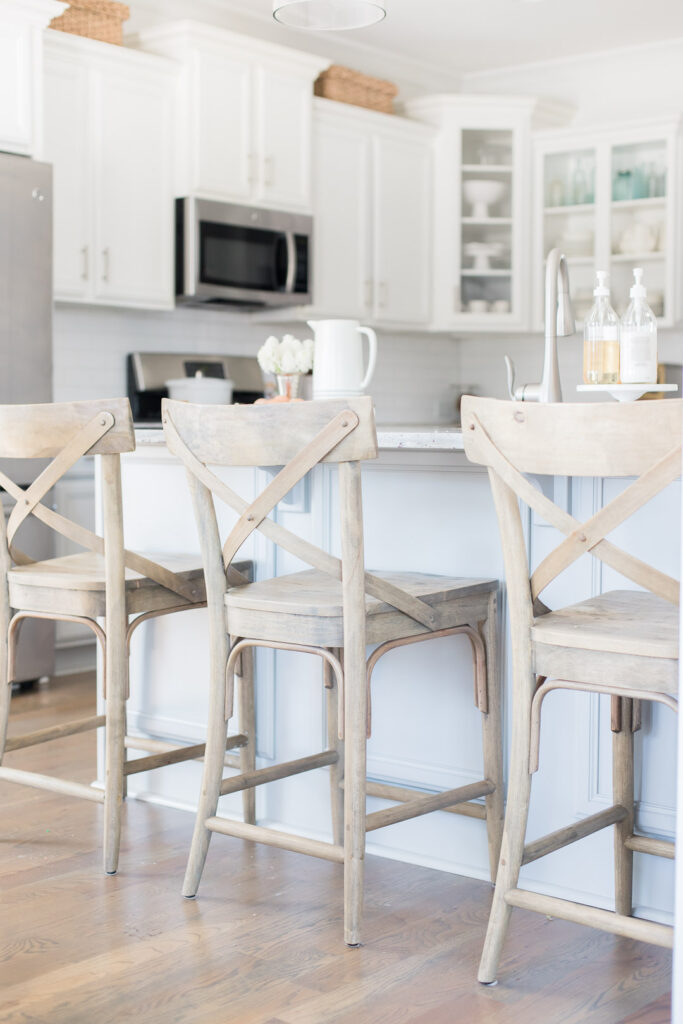 Do you love white bright spaces? You are going to love this Light and Bright Spring Home Tour and spring decorating ideas | Adrienne Elizabeth Home Style Life| #springhometour #springdecor #whitedecor #modernfarmhouse #modernfarmhousestyle #springflowers #springdecorideas #whitekitchen #jillianharrisstyle #monikahibbsstyle #studiomcgeestyle #frenchcountry #vintagedecor #barstools #woodbarstools #worldmarket