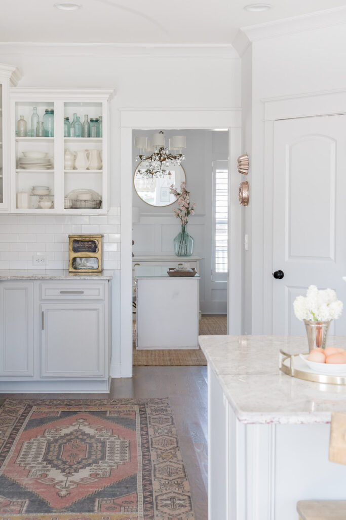 Bright white kitchen Tour for Spring! You are going to love this Light and Bright Spring Home Tour and spring decorating ideas | Adrienne Elizabeth Home Style Life| #springhometour #springdecor #whitedecor #modernfarmhouse #modernfarmhousestyle #springflowers #springdecorideas #whitekitchen #jillianharrisstyle #monikahibbsstyle #studiomcgeestyle #frenchcountry #vintagedecor