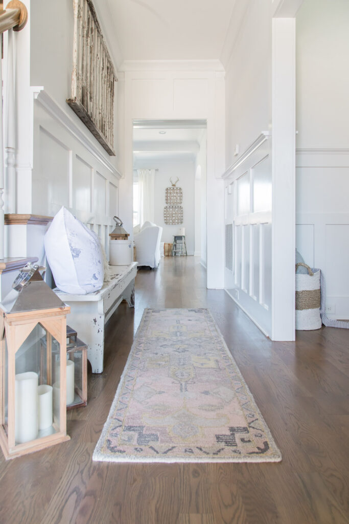 Do you love white bright spaces? You are going to love this Light and Bright Spring Home Tour and spring decorating ideas | Adrienne Elizabeth Home Style Life| #springhometour #springdecor #whitedecor #modernfarmhouse #modernfarmhousestyle #springflowers #springdecorideas #Woodlantern #farmhousebench #pinkrug